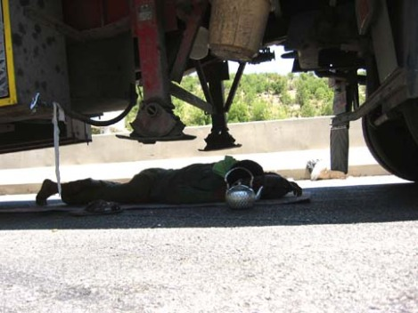 A truck driver sleeping under his vehicle at the Masnaa border crossing in Eastern Lebanon. (Photo: Stefan Christoff/http://electronicintifada.net)